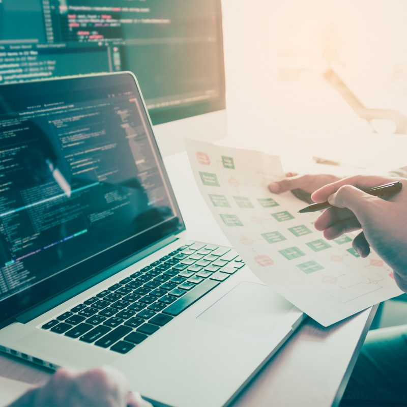 Two people coding code program programming developer computer we
